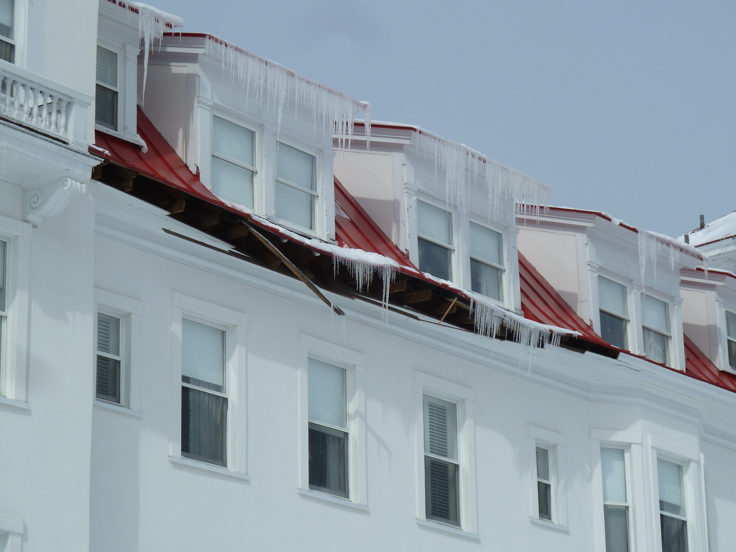 Figure 2:  Ice dams and icicles can cause damage to roof construction. They can be particularly difficult to repair and prevent in older historic structures.