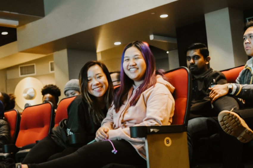 Board member Thi Bui (left) and audience member Lauren Lee (right) smile for the camera.