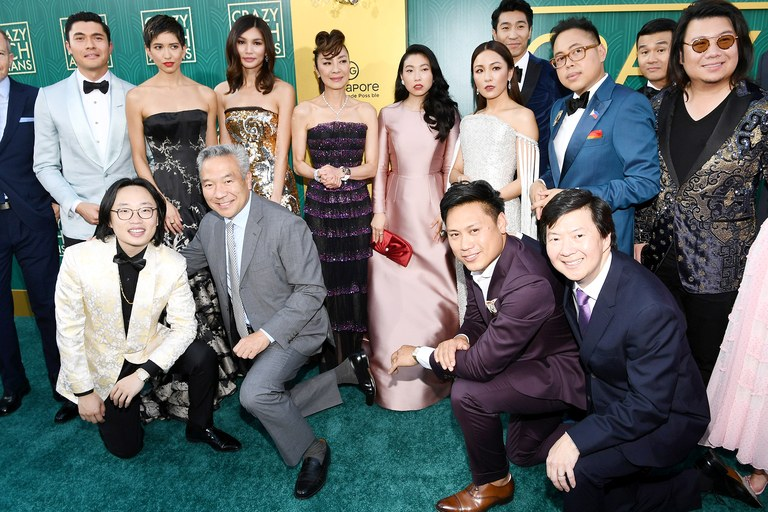 The cast of Crazy Rich Asians pose for a group photo at the LA premiere on August 7, 2018. The remarkably East Asian presenting cast has been critiqued for not being representative of Singapore's ethnic minorities, accounting for over a quarter of the country's population.