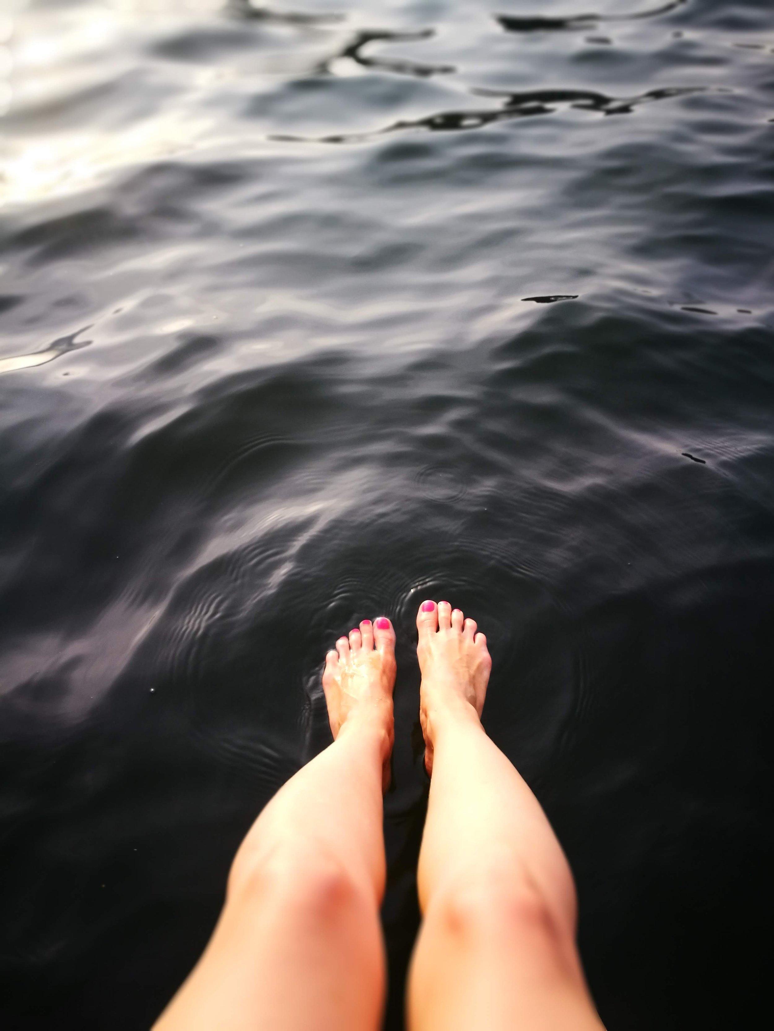 liliya-dyulgerov-799724-unsplash legs in water.jpg