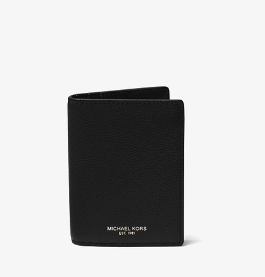 WALLET - Michael Kors has got you covered, pick up a classy new wallet for him, like this one, for $118.