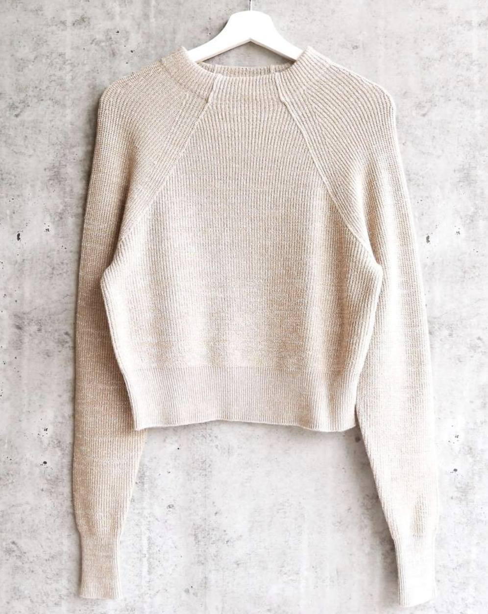 SWEATER - This mock neck knit sweater from Free People will look great on her. On sale right now for $46 at Nordstrom.