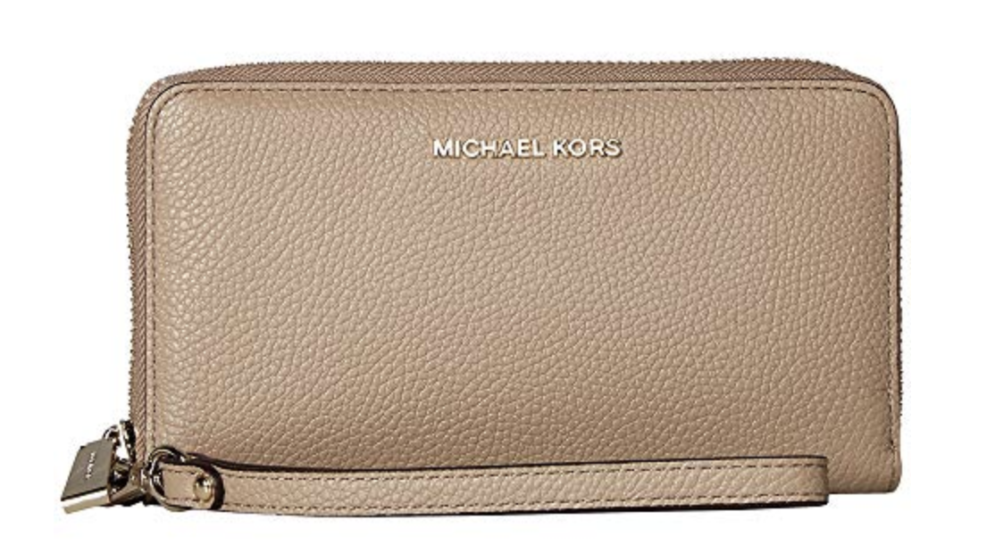 WALLET - This Michael Kors one literally fits everything, even her phone. We found it at Zappos for a great deal of $89.