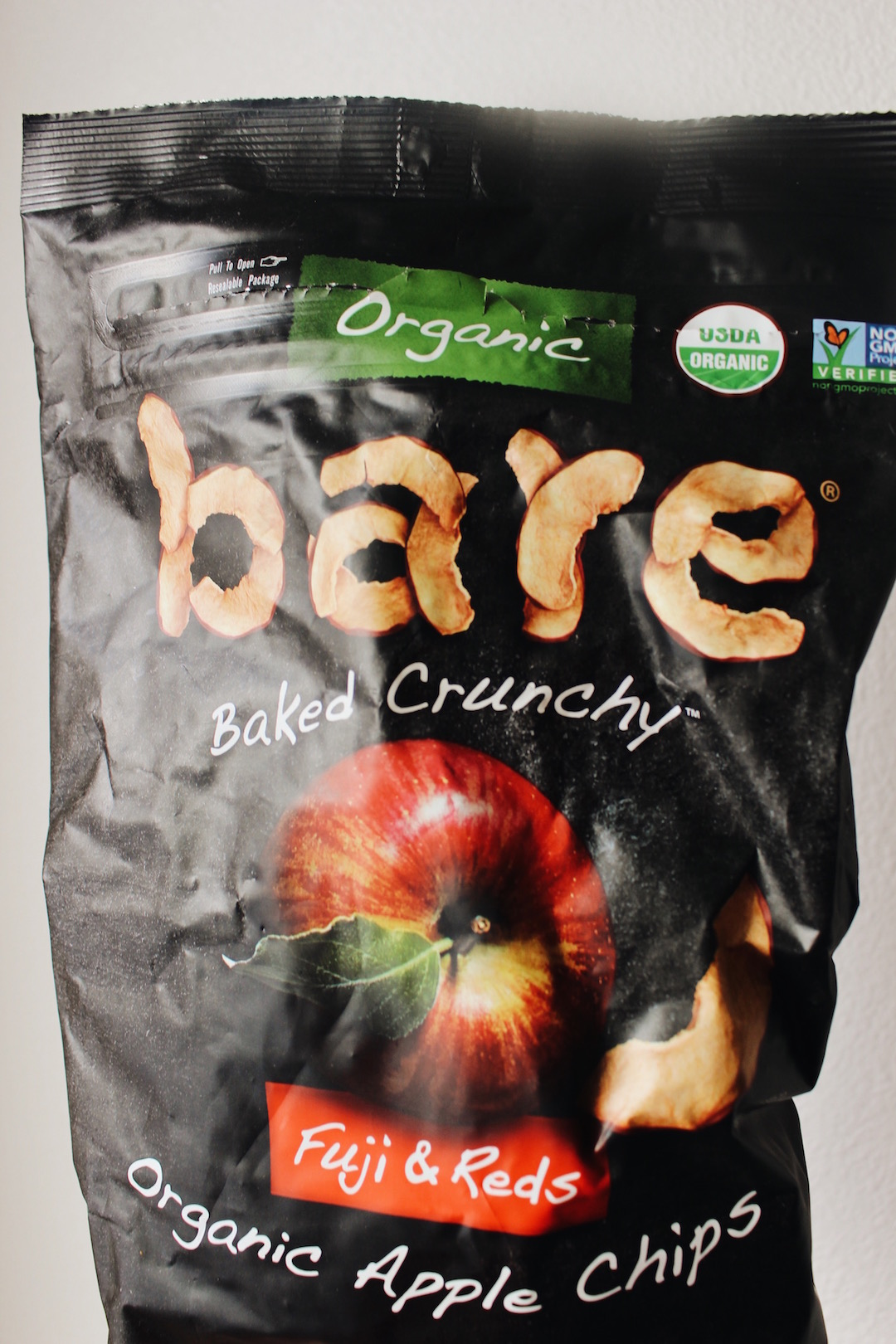"""APPLE CHIPS - These will ensure that you get more fruit into your day. Apples are rich in fiber and antioxidants. Costco, Target and Amazon all carry this brand called """"Bare"""", but you can also make your own! Just heat your oven up to 225 degrees, slice up your favorite kinds of apples, maybe even add a little cinnamon, and let them crisp up for about 45 minutes. (Maybe even add peanut butter on the side for more filling snack.)"""
