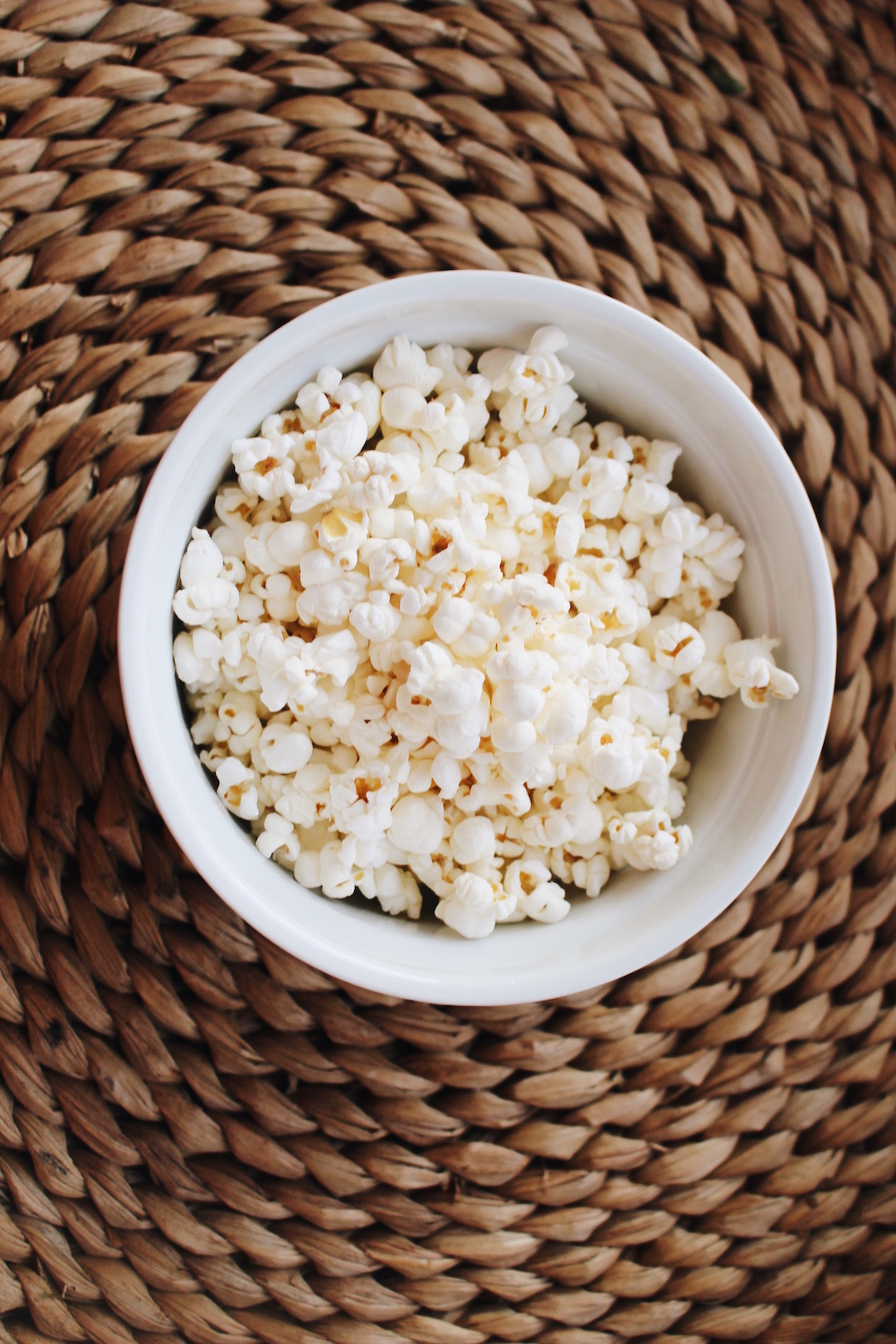 """POPCORN - Such a light, yet satisfying snack. Trader Joe's makes great """"Heirloom Popcorn"""" with avocado oil & pink salt, or Lesser Evil makes this wonderful avocado/coconut oil popcorn. Popcorn is a great source of fiber and antioxidants and avocado oil/ghee both contain healthy fat that your body needs."""