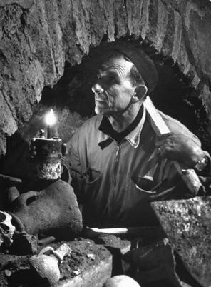 Foreman Examines Ancient Archway in Necropolis