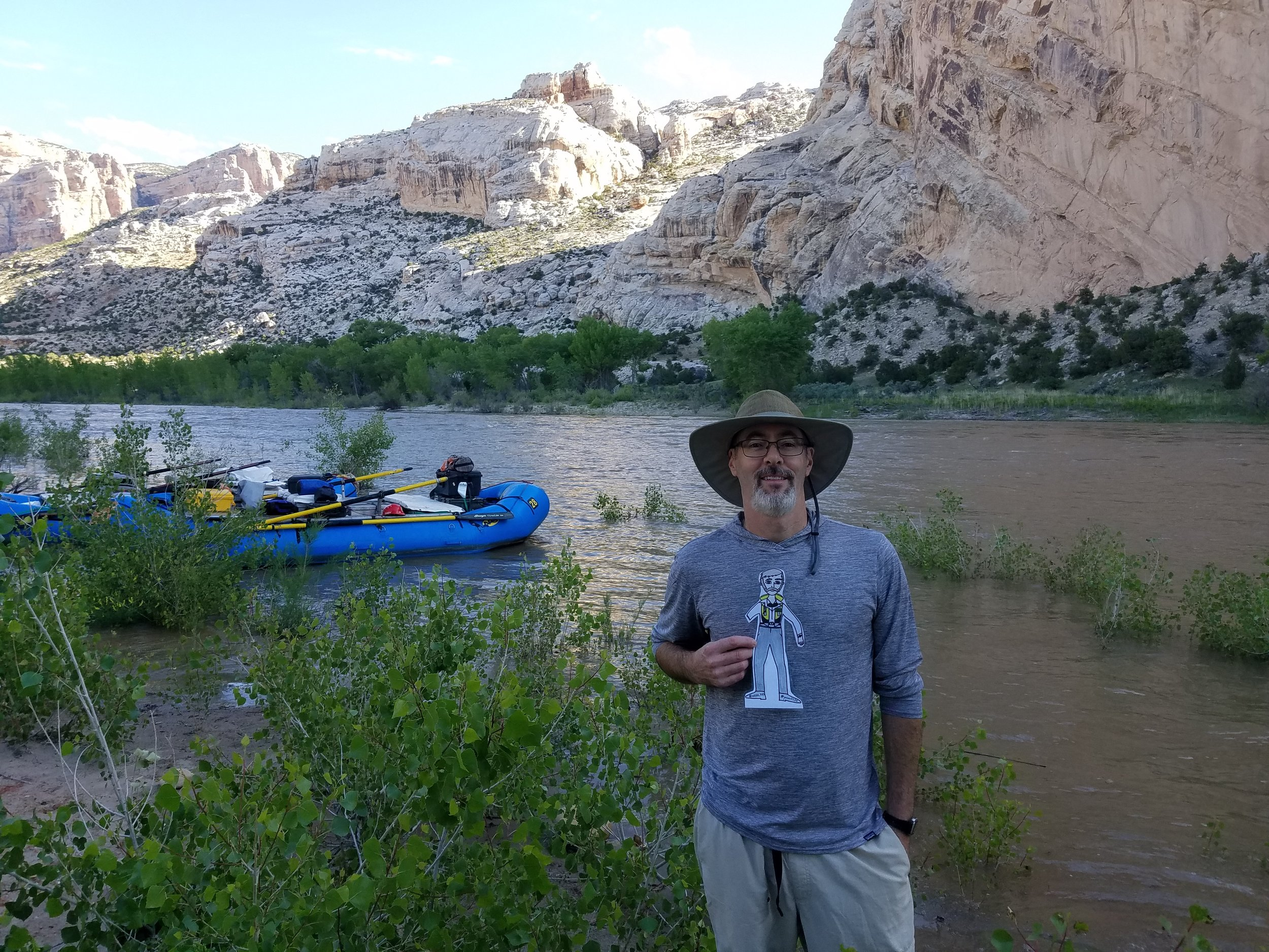 Mitchell Eaton, USGS, with Paper Powell as he prepares to enter the expedition at Split Mountain