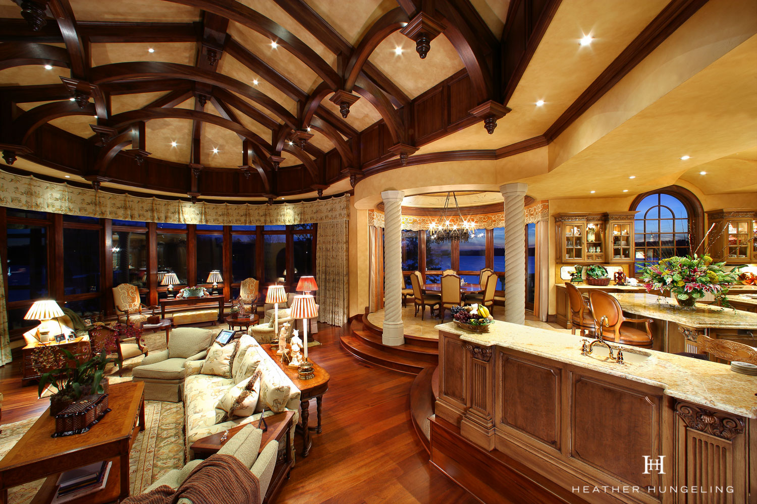 This amazing Tuscan kitchen overlooks a Great Room with a vaulted ceiling and beams.