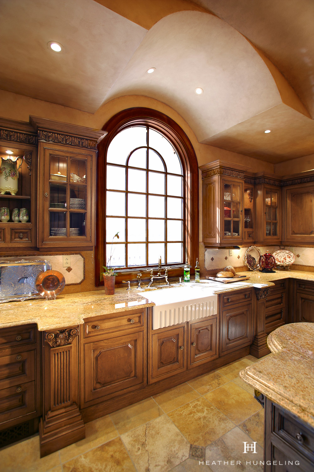 The fluting on this apron front sink maintains the elegance of the overall kitchen. Clive Christian luxury Tuscan kitchen in French Oak.