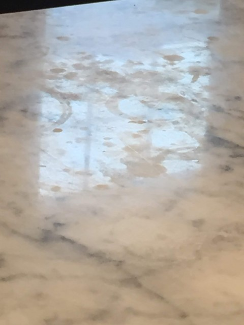 This is an example of badly etched marble. Most homeowner's would probably only have a few of these spots over time. However, if it reaches this level, you can opt to have the counters re-polished/honed to remove the etch marks.