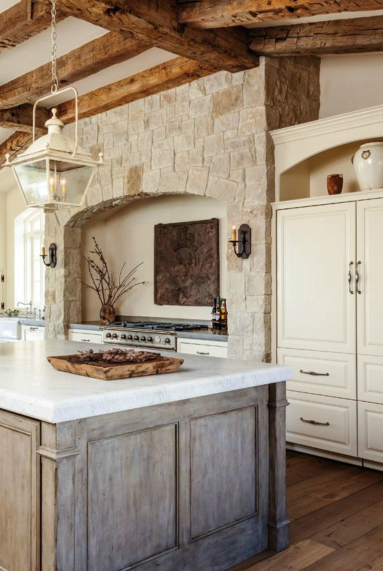 This hood design simply showcases a lovely stone with a simple arch over the range.  Source:  Carolyne Ferguson Design  via  Hello Lovely