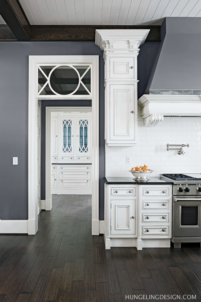 """Grey walls contrast nicely with the white cabinetry, painted """"Simply White"""" by Benjamin Moore."""