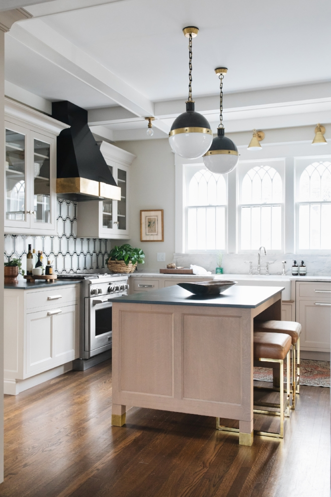 Source:  Jean Stoffer Design . This designer restricted the trendy black and white backsplash tile to one wall, making it an easy task to update later when the black and white trend is over.