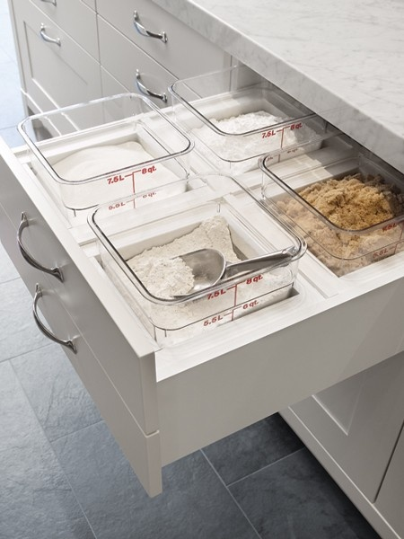 Divided bins for a baking zone are a must in a dream kitchen and area especially useful in the island.
