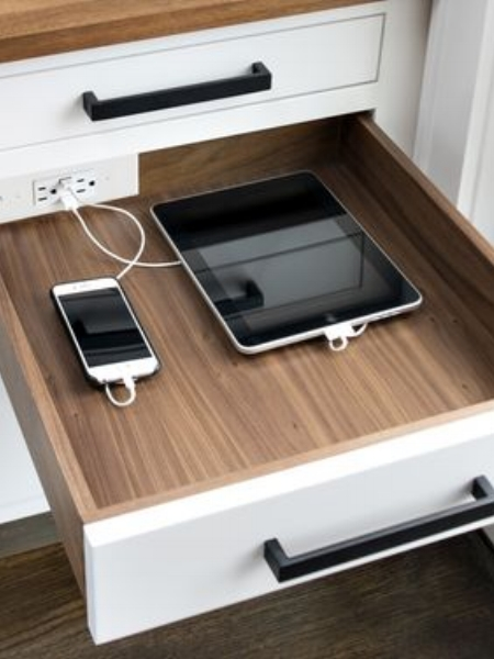 A drawer to hold charging appliances is a nice touch to include in any sized dream kitchen.