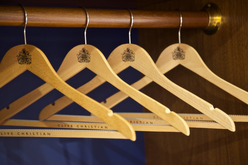 Use matching wooden hangers to unify the look of your luxury closet. They will bring visual continuity and a sense of spaciousness between garments. Get more of  My Top 10 Tips to Create the Perfect Luxury Closet .