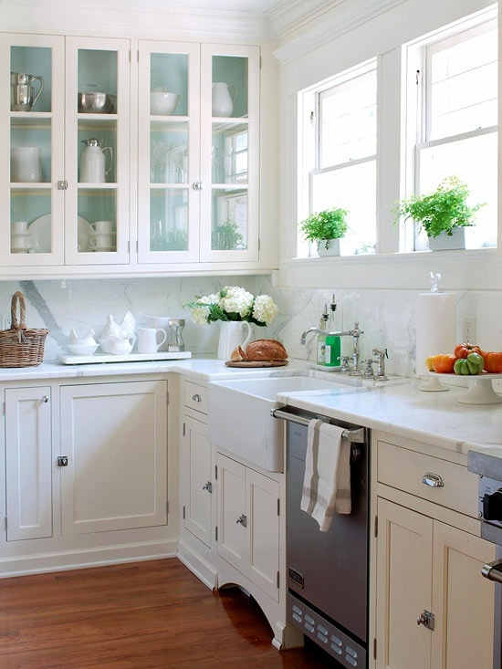 How to Make Your Kitchen Beautiful with Pretty Cabinet Details, Part 1 (Cabinet Interiors)  Differentiate your white kitchen from all the others by painting the interiors of your glass cabinets a soft blue. #kitchencabinetdetails.
