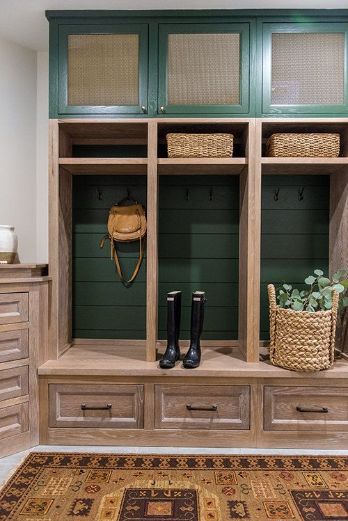 How to Make Your Kitchen Beautiful with Pretty Cabinet Details, Part 1 (Cabinet Interiors)  Horizontal shiplap is enhanced as the backdrop of these mudroom cabinets by painting it a rich, forest green. #kitchencabinetdetails.