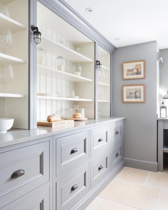 How to Make Your Kitchen Beautiful with Pretty Cabinet Details, Part 1 (Cabinet Interiors)  Instead of painting the interior and accent color, consider painting the exterior a particular color and painting the interiors a soft ivory as was done in this Humphrey Munson kitchen. #kitchencabinetdetails.