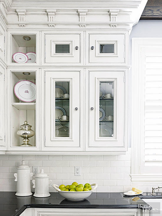 Double stacking glass cabinet doors can be a great way to get added height but add some visual partitioning.