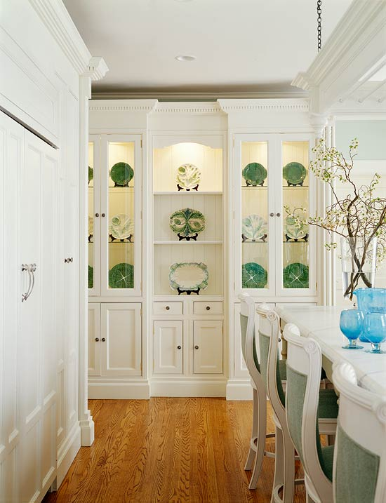 Clustering a few tall units with glass cabinet doors together creates a stronger focal point - especially when displaying a collection.