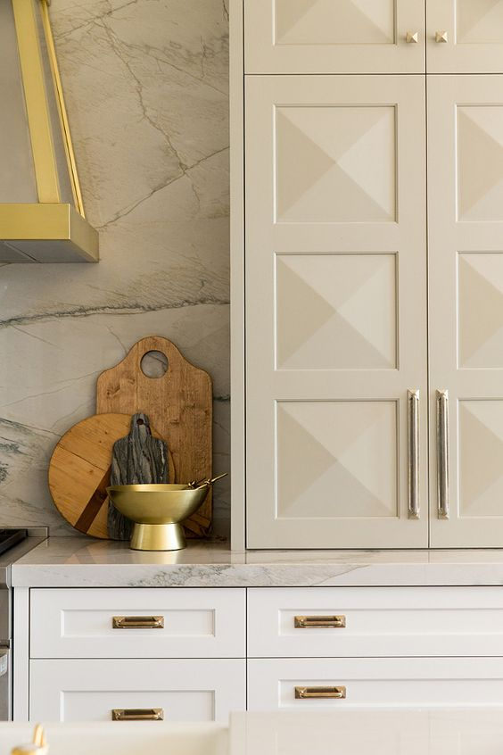 Upper cabinetry with multiple, pyramidal panels gives great character to this kitchen by Whittney Parkinson Design. Discover other great details & cabinet door styles to incorporate into your next kitchen.