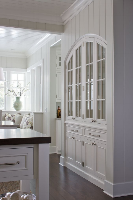 """Anytime you can build cabinetry into the wall, the look is instantly elevated. It takes advanced planning to create these little spaces, but they create """"moments"""" in the design that are very valuable. These pretty glass cabinet doors could anchor the look for the whole kitchen."""