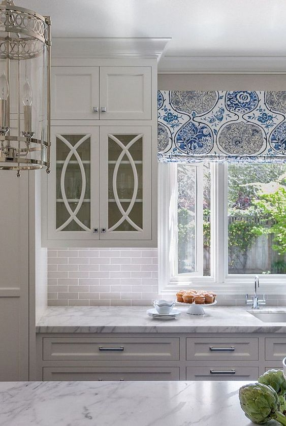 """""""Scissor"""" muntins are a nice transitional option for glass cabinet doors."""