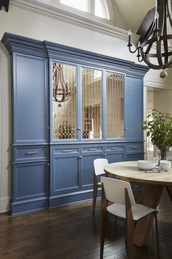 Leaded glass cabinet doors are melded with the privacy of mirror to create a stylish storage hutch in this kitchen.