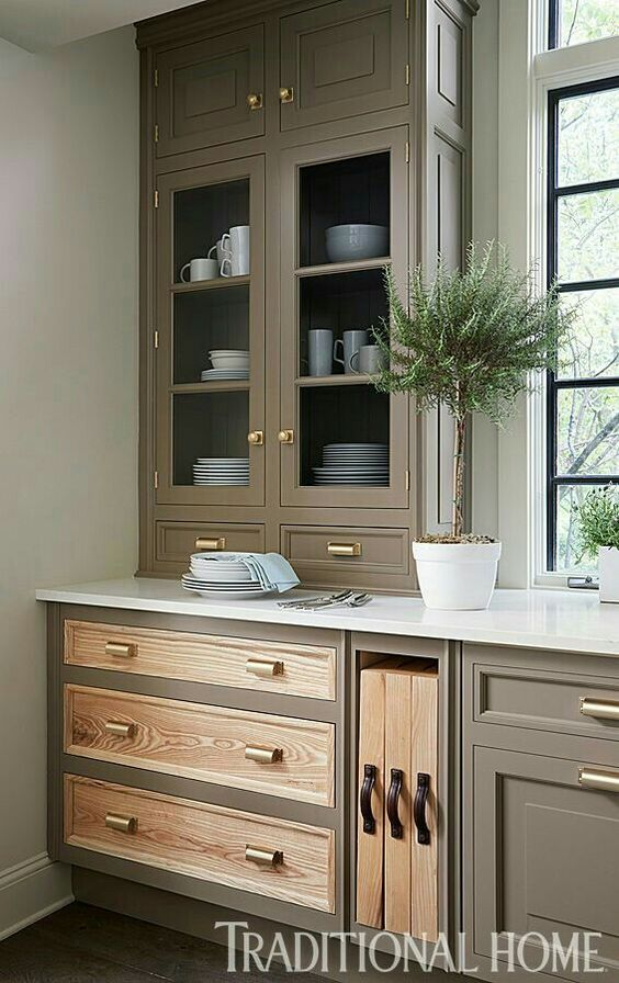 Two-tone cabinet door styles, such as shown in this kitchen by Christopher Peacock, illustrates the principle that unique details matter.