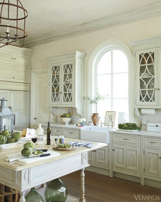Muntins on these glass cabinet doors are a subtle reference to the raised panel on the lower cabinetry.