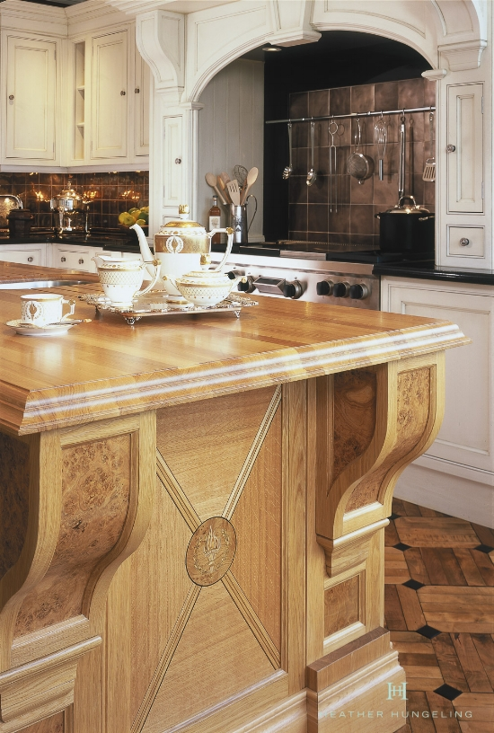Marquetry inlay panels and burled oak corbels are special features on this Clive Christian kitchen island. However, they can be incorporated into cabinet door styles as well. Designed by Heather Hungeling.
