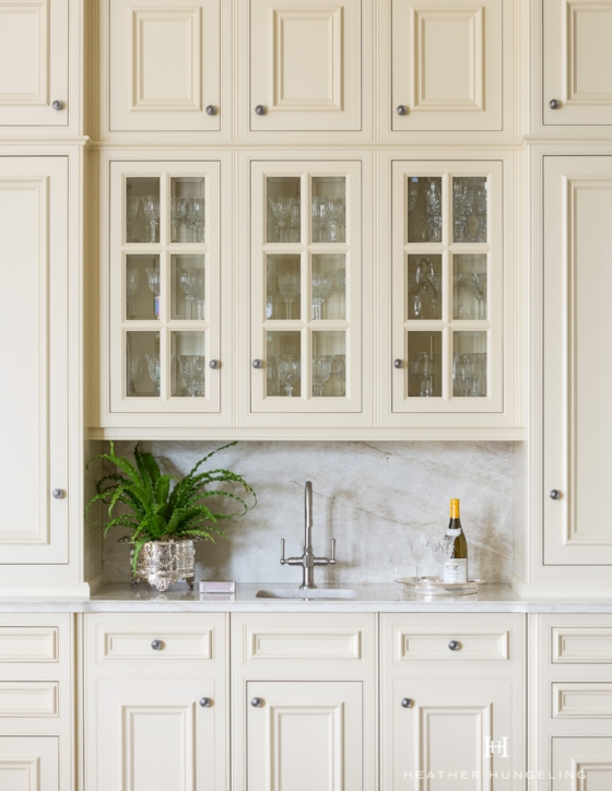"""Beveled, """"true divided lights"""" on these glass cabinet doors provide just the right amount of luxury and sparkle for a traditional kitchen."""