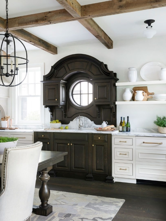 A two-tone kitchen with pretty cabinet door styles by Bria Hammel Interiors. I love how the darker cabinetry is set up to look like a fabulous antique that was incorporated into the kitchen.