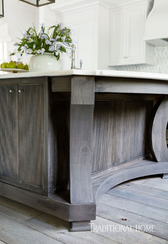 Reeded cabinet doors are on the rise in popularity. Savvy designers, like Dana Wolter, know that using interesting cabinet door styles like this, create character in an otherwise classic kitchen.