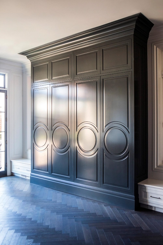 Circular cabinet door styles on the custom cabinetry designed by Leo Designs Chicago.