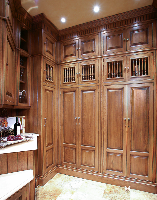 Spindle doors are perfectly at home in an English-style larder like this one. Discover other ways that you can use unique cabinet door styles to bring character to your future kitchen.