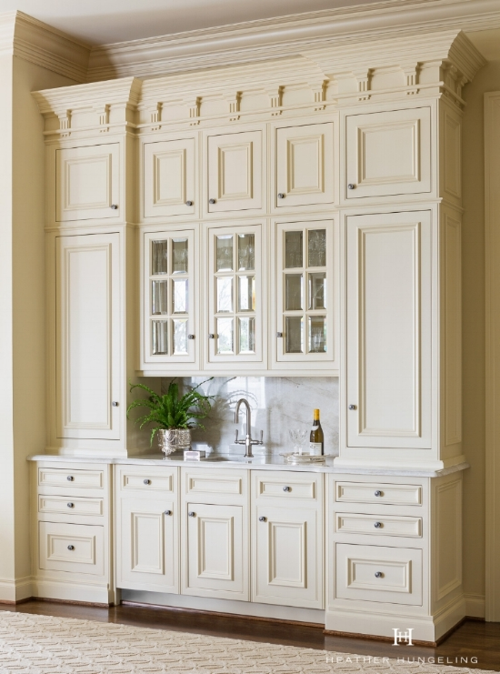"When cream kitchen cabinets are the goal, choosing the perfect cream can be a bit of a challenge. Colors with yellow undertones are often hard to get just right as you often need to tone them down more than you think. This pretty Clive Christian hutch is painted a creamy beige color by Sherwin Williams, called ""Believable Buff."""
