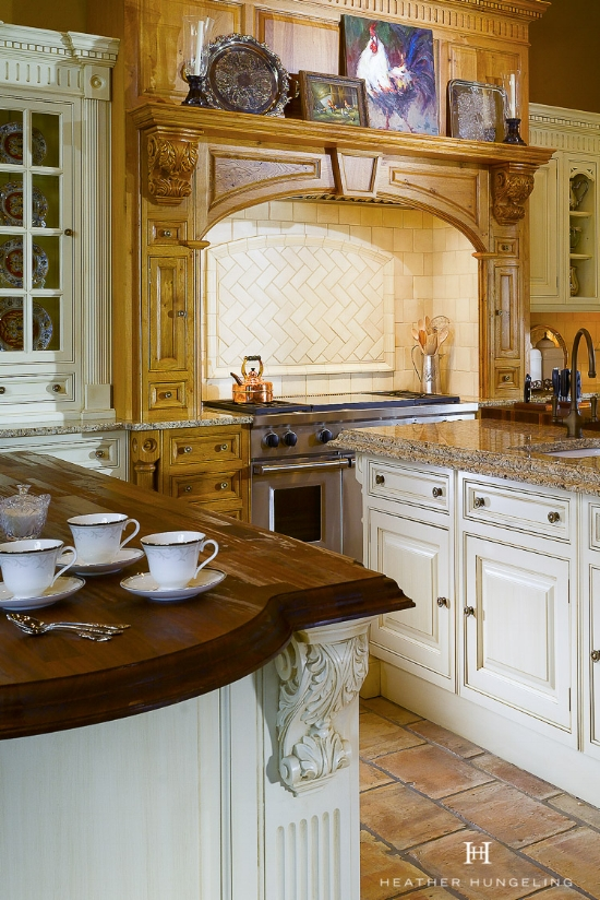 A Clive Christian kitchen is often recognizable by the classic cream kitchen cabinets and beaded details on the doors.