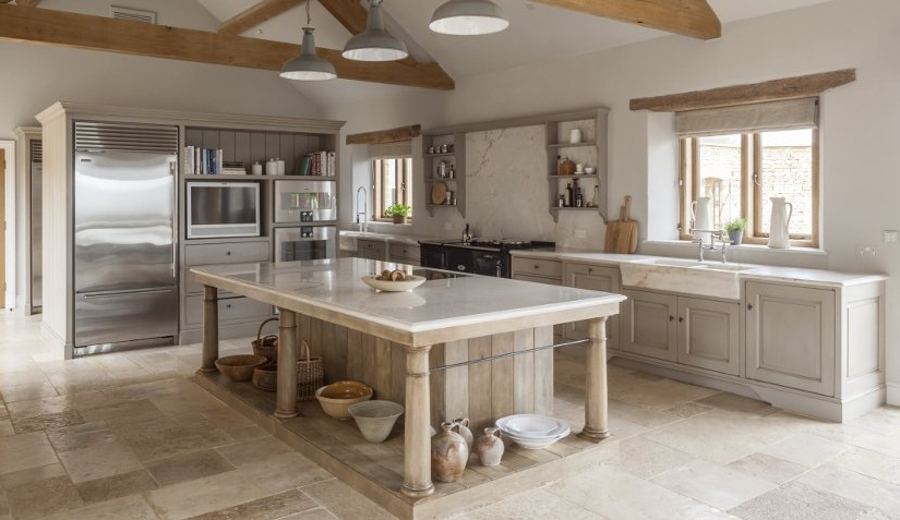 Since the kitchen island is really an evolution of a working table in a traditional English kitchen, it makes sense to incorporate that table feeling into the design by using legs and open shelving when possible. Kitchen Design by Artichoke Ltd.