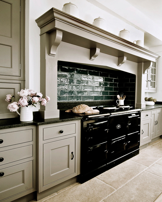 While cream colored AGA cookers were popular in the past, black ones seem to dominate the market now. English kitchen by Thomas Ford & Sons.
