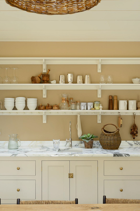 The British are as enamored with open shelving in the kitchen as we are here in the U.S.; however, I think they can claim ownership of this concept long before us! Cream-colored English kitchen by DeVol Kitchens.