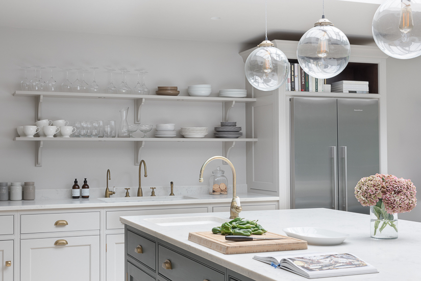 Open shelving is not a recent trend in the British market; rather it reflects a long heritage of practical and hard-working kitchens. While minimalist, floating shelves are popular in the U.S., a more traditional style of shelving with brackets is seen in the U.K. English kitchen by Humphrey Munson