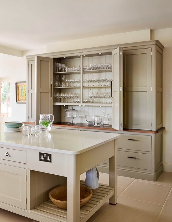 A stand-alone hutch or kitchen dresser is a popular feature in an English kitchen. While offering very versatile storage, it also breaks up the look of too many hanging cabinets.