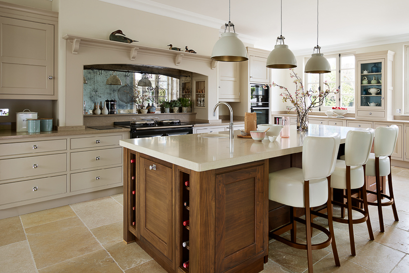 Two-tone kitchens are popular in the U.K., as well as in the U.S. However, the U.K. market has really embraced the look of painted cabinetry accented with rich walnut and oak. English kitchen design by Martin Moore.