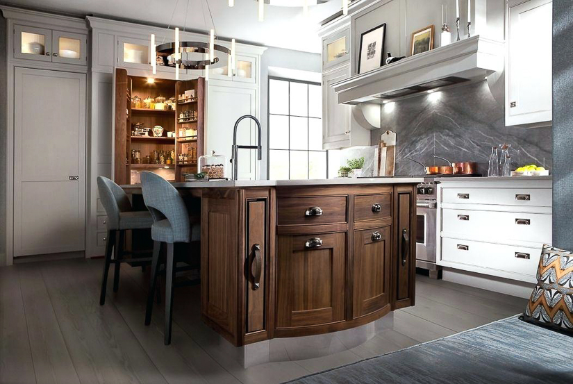 Smallbone of Devizes is an English kitchen company with a lot of name recognition - even here in the U.S. They showcase a favored look of white cabinetry mixed with a dark stained island.