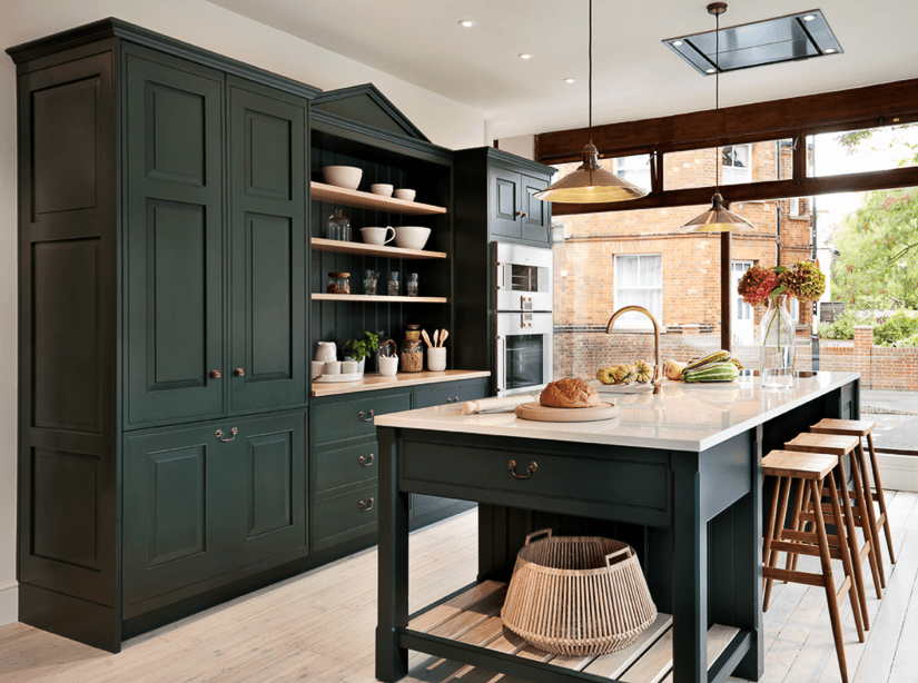 A transitional English kitchen design by Teddy Edwards, features a stream-lined pediment.