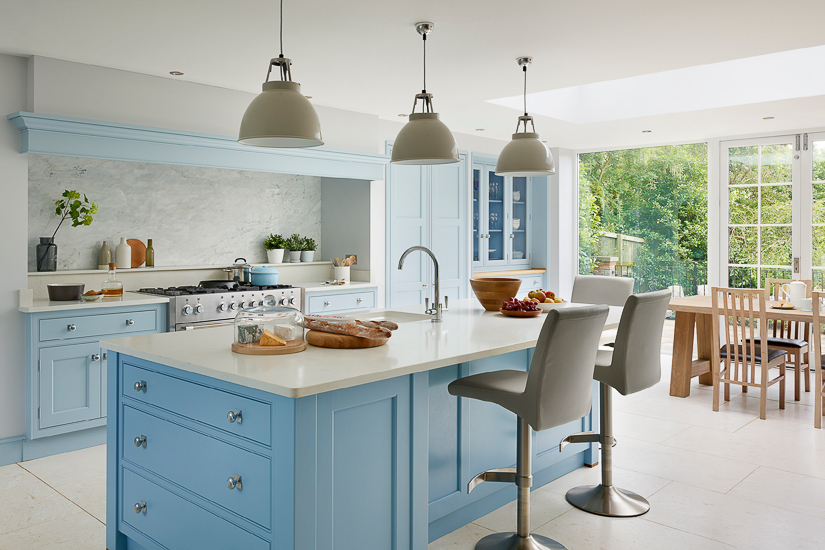 For an English kitchen, an entire wall of glass sliders or French doors is often used to create connectivity to the garden.