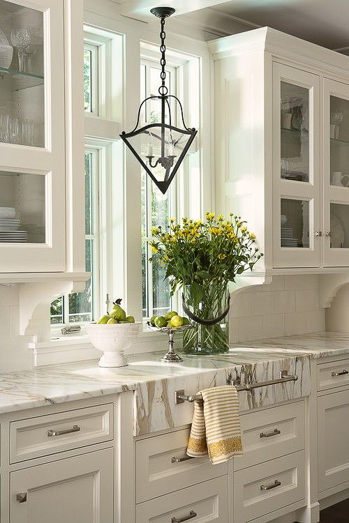 Marble was used to craft an apron front detail above two drawers and was then fitted with a towel bar. A beautiful and practical addition. Get the rest of my Kitchen Marble Ideas…for those who really love marble.