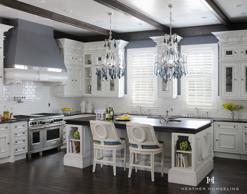 This large kitchen island features a wood countertop made from Wenge wood. Wood countertops are a helpful option if your island exceeds the size of natural stone slabs.